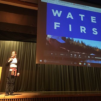 Natalie presenting about Water First