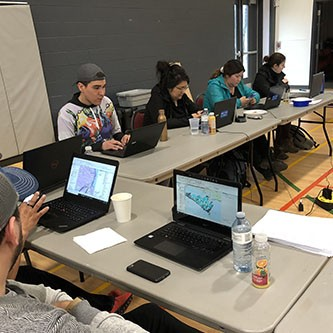 Interns learning the Esri Canada software