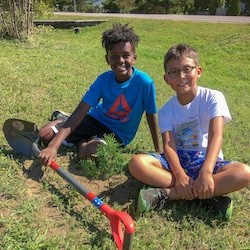 Saugeen First Nation students planting trees.