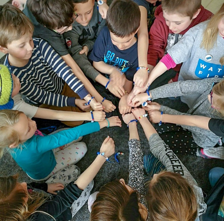 Students from G Theberge School in Temiscaming, Quebec, wearing beaded bracelets made as part of a Water First workshop.