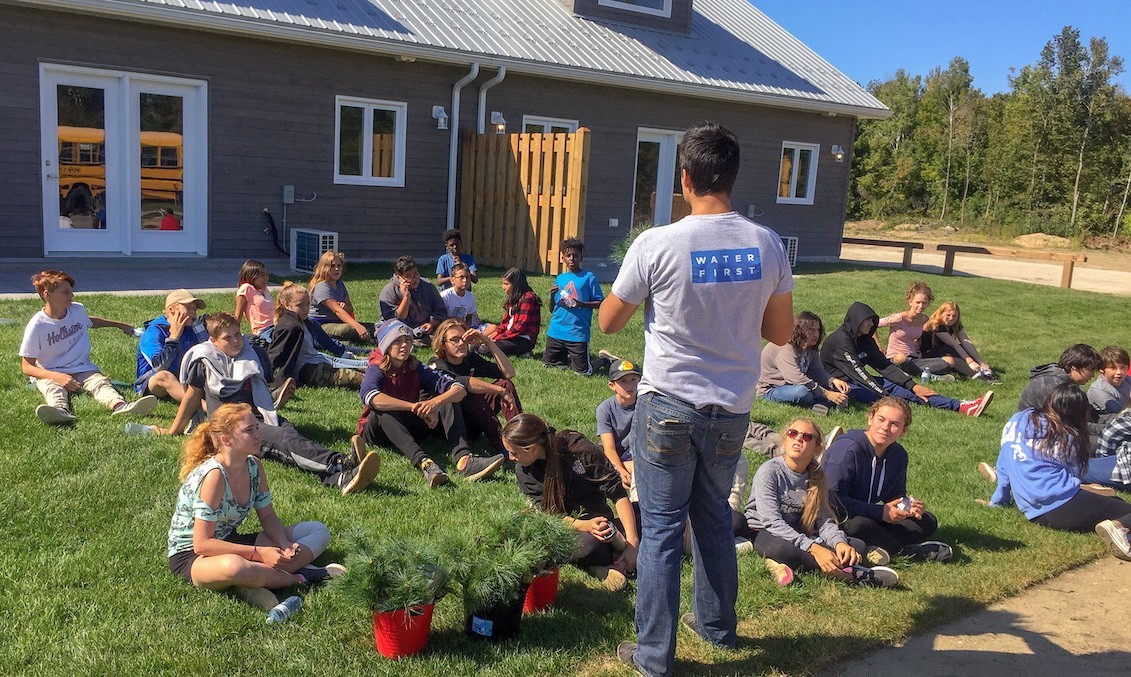 Dillon talking to students before planting trees at Saugeen First Nation.