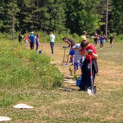 Students from Holy Cross Catholic School planting trees.