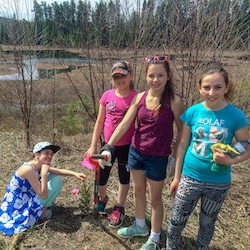 Students from Joseph Kennedy Public School planting trees.