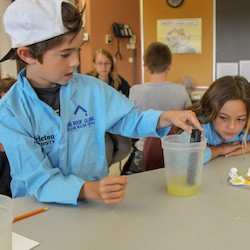 Students from Laura McKenzie Learning Centre checking water quality.