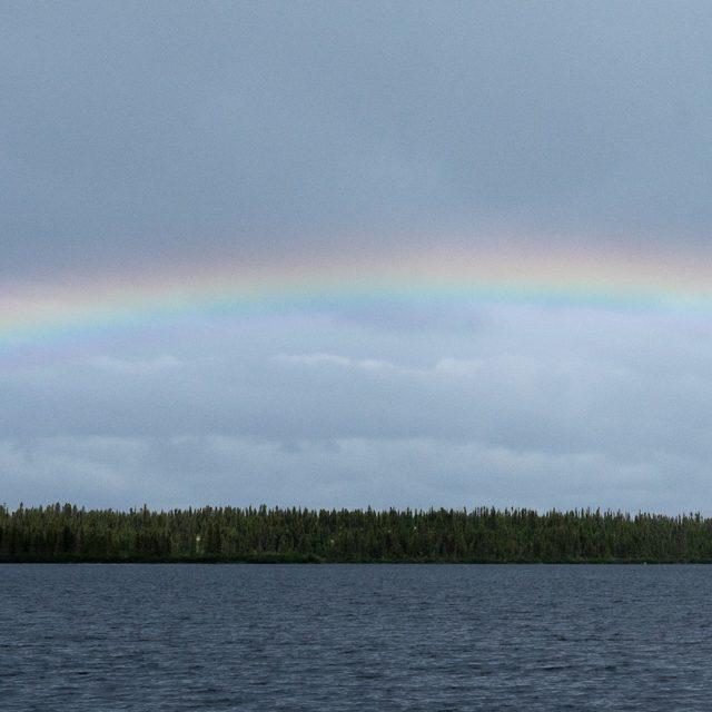Photo of a rainbow over a lake in Naskapi.